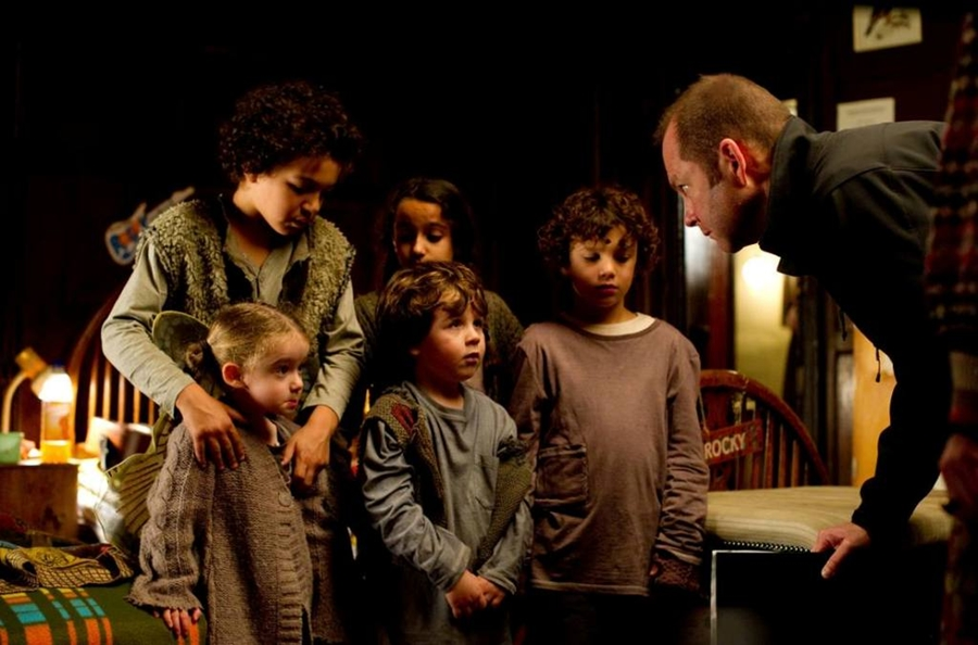 Christopher N. Rowley with the orphans